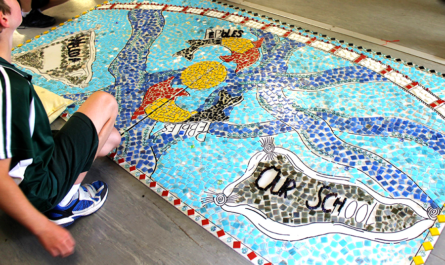 ARTWORK: Students working on the mosaic.