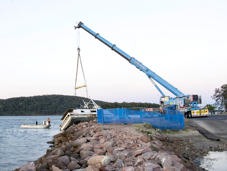 Crane, tug and trawler in place prior to removal from water. Photo by:  Square Shoe Photography