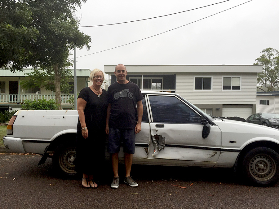 Bettina and Paul Brooke with their damaged vehicle.