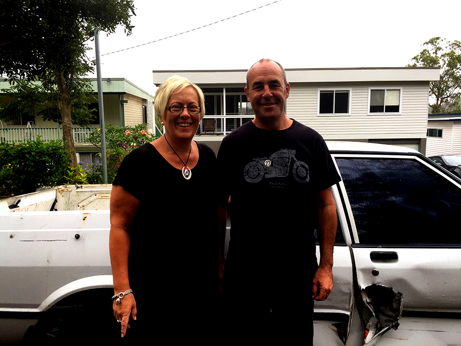 Bettina and Paul Brooke with their damaged vehicle. Photo by Jo Finn