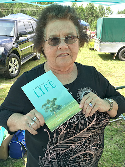 Author Gwenda Cousin with her book 'Poetry of Life' at Medowie Markets last week