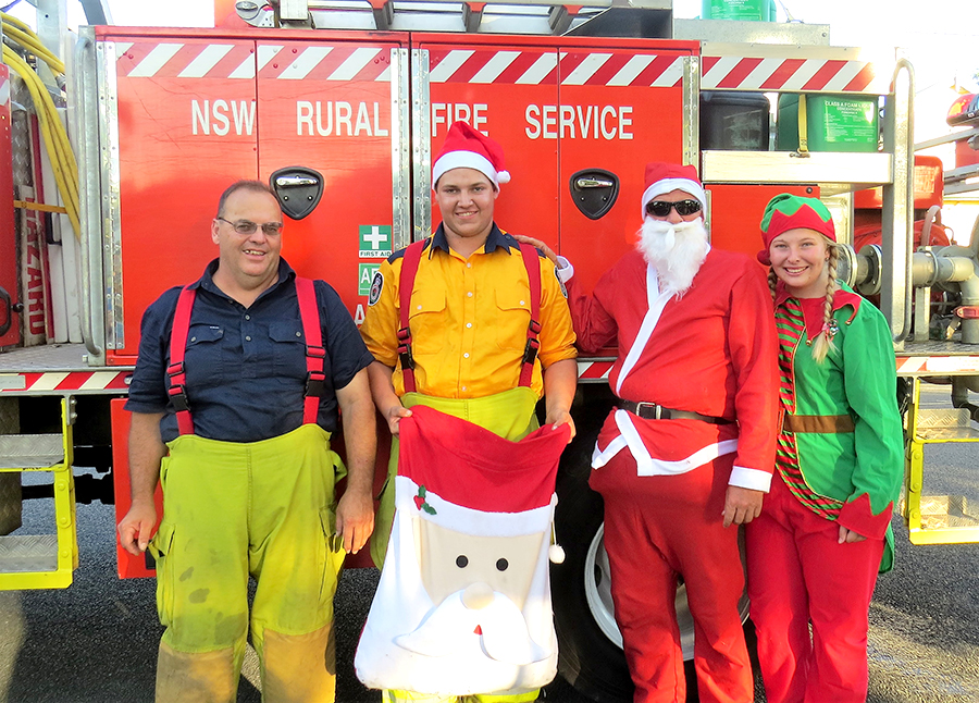 FESTIVE SPIRIT: Brigade Captain Mark Hartwell, members Jake Blanch and Meagan Terry with Santa.