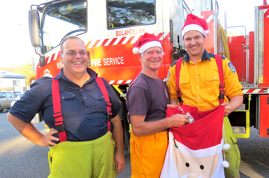 FESTIVE SPIRIT: Brigade Captain Mark Hartwell with Graham Rowell and Jake Blanch.