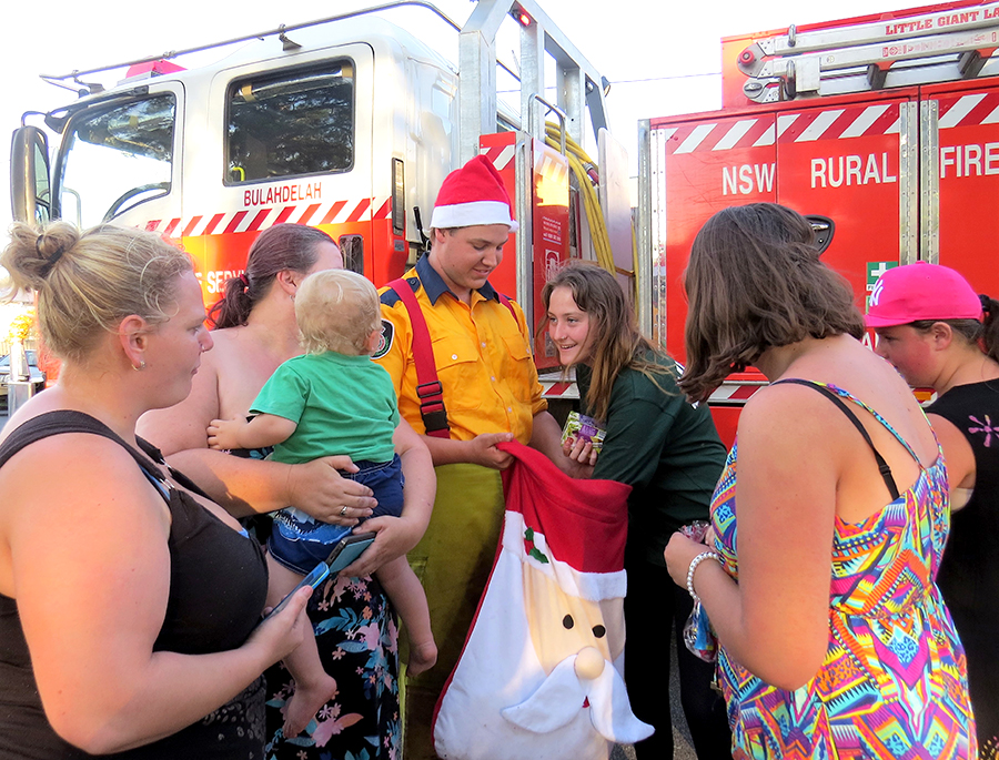 FESTIVE SPIRIT: RFS member Jake Blanch shares Christmas treats with the community.