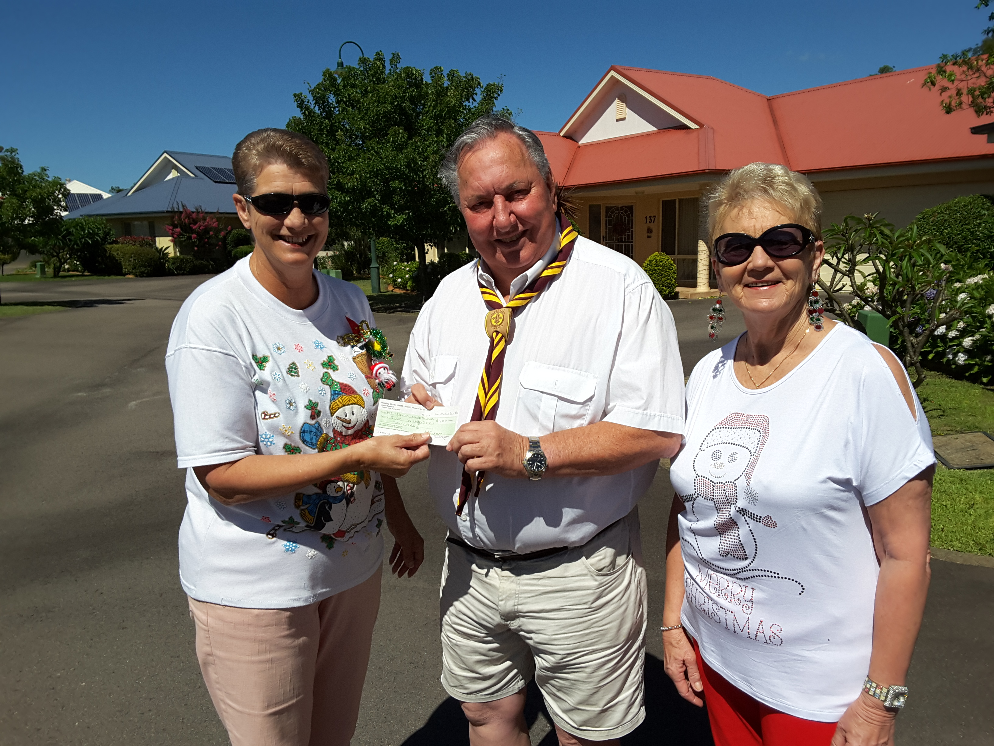 $500 presented to Neil Renfrew for 1st Hawks Nest Scout Group by Mary Cooper and Lynda Curran.