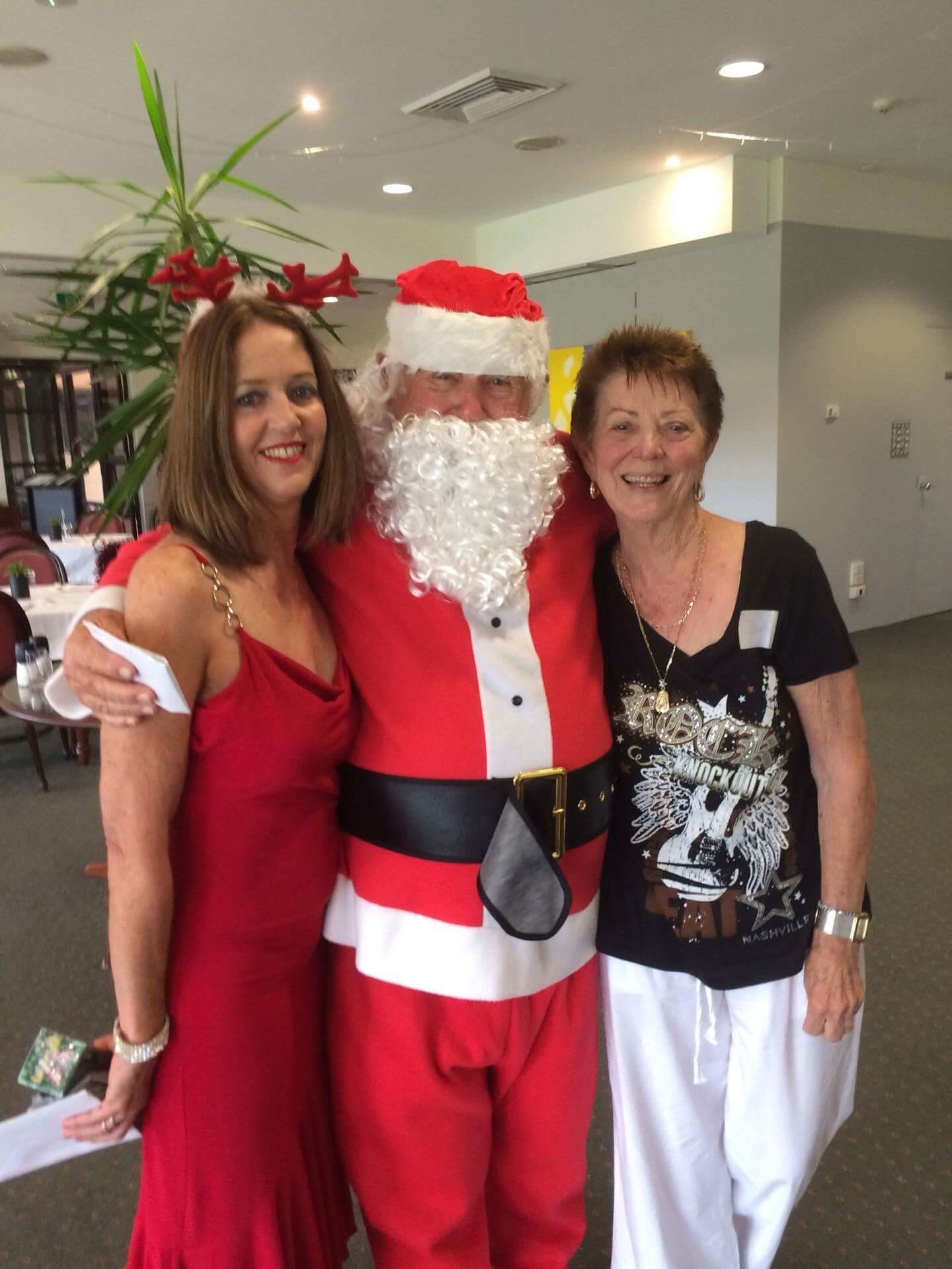 Vicki Tillott with Santa (aka Ted Brown) and Joan Roach