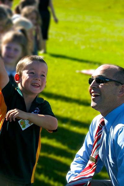 St Philip's Christian College's Principal in 2011 Chris Walkling with student Padriac Jones. Photo: Supplied