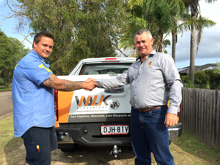 Dwayne Murphy from Medowie Marauders Rugby Union Club with the owners of Walk Electrical Daniel and Ashton Walk