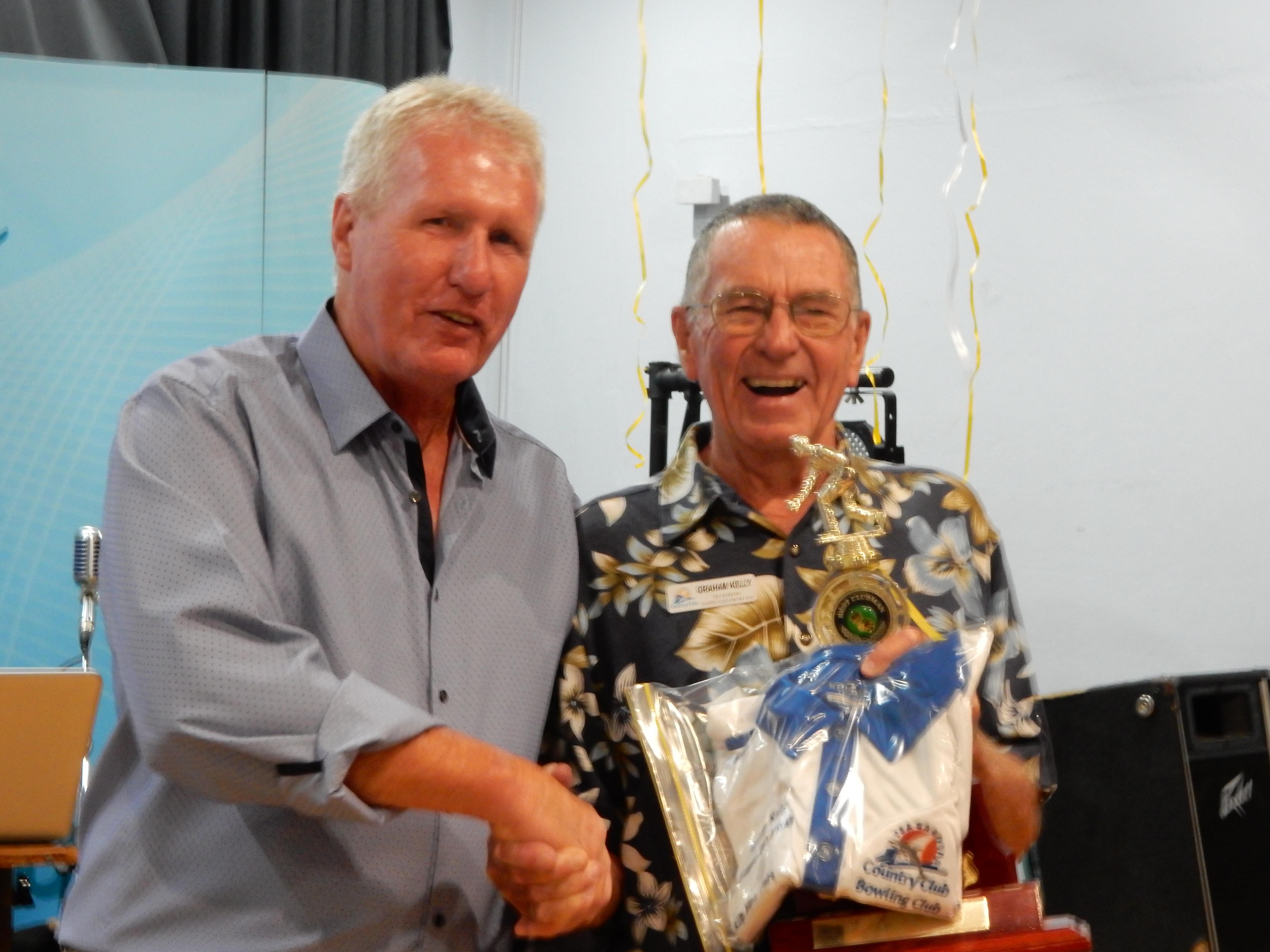 Club President Keith Smith awarding Club Treasurer Graham Kelly with the