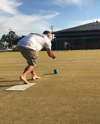 BAREFOOT BOWLS: Allan Freihaut bowling in the 12-end match.