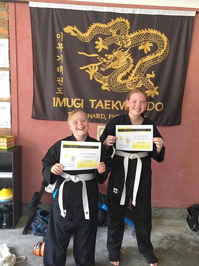 Stacey and Renee Binskin after achieving their first yellow tip gradings.