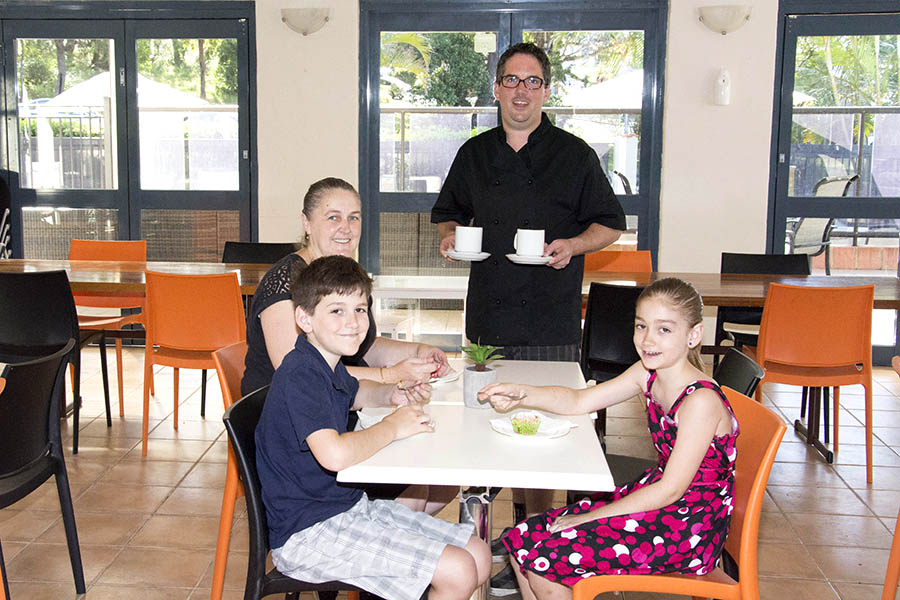 The Nicolls family enjoying morning tea at Eat's @ Bay Breeze cafe. Ben and Chelsea Nicolls enjoying freshly made muffins whilst mum Kylie and dad Guy Nicolls enjoy freshly made coffee. Photo by: Square Shoe Photography
