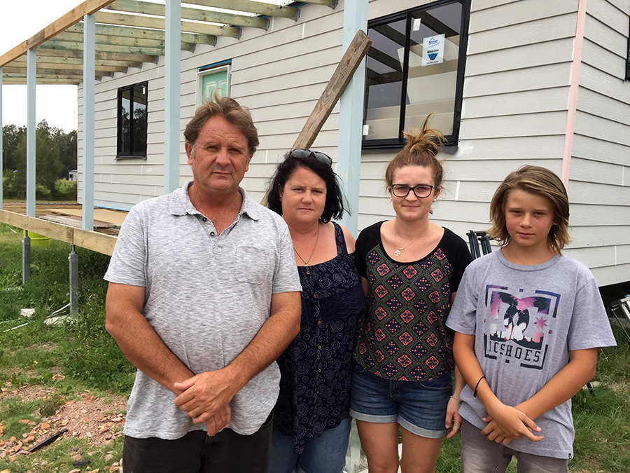 Brian's son-in-law Darren, daughter Kim and grandchildren Hannah and Seth Ogilvie in front of Brian's unfinished cottage. Photo by Jo Finn