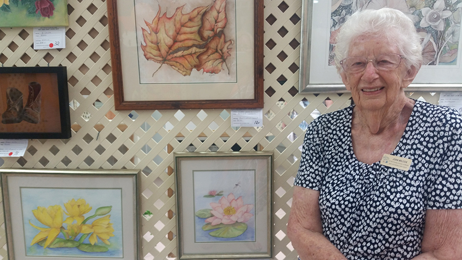 FOUNDING MEMBER: Joan Wilcox with two of her watercolours.