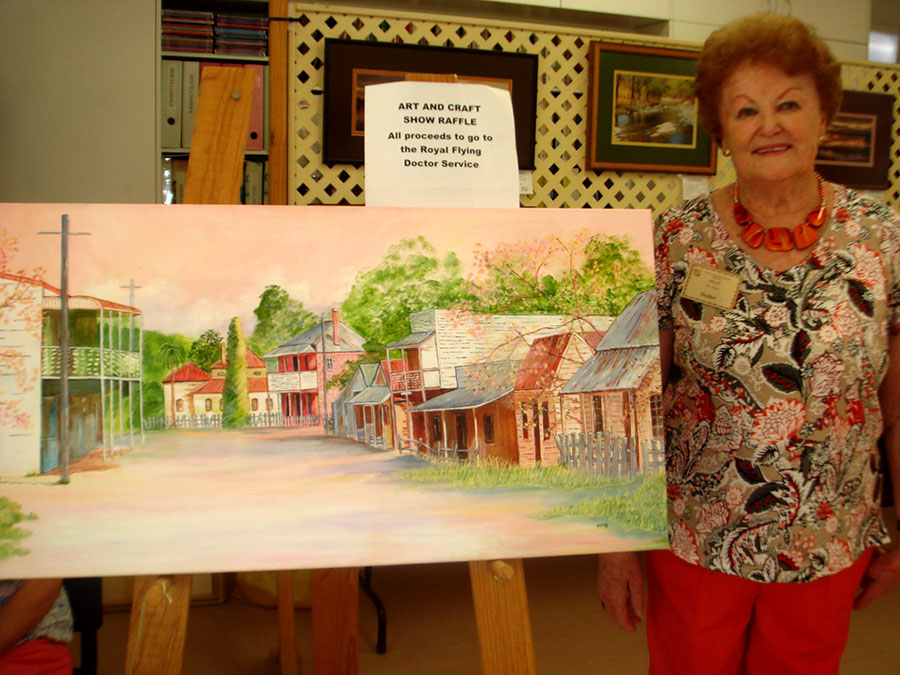 DONATED ARTWORK: Artist Heather Baker with her painting of Sofala.