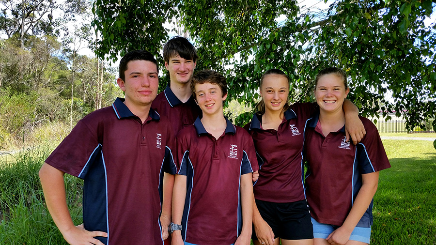 Jade Kehr, Ashley Craddock, Jackson Kennedy and Alec and Levi Warncke working hard on their school holidays to raise funds for their trip.