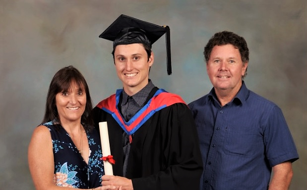 GRADUATION DAY: Mitchell Markham with his proud parents Karen and Bradford.
