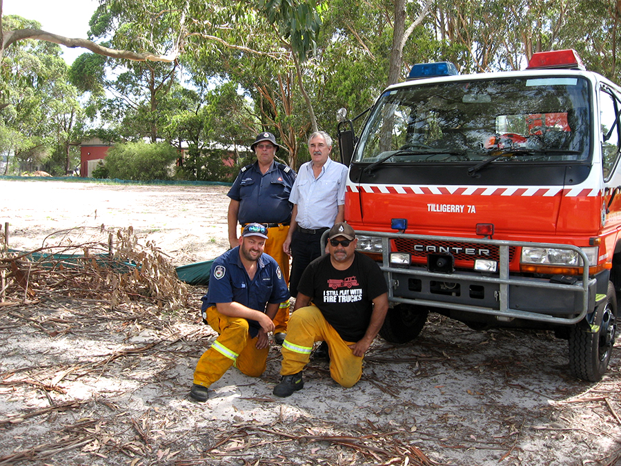 Tanilba Fire Captain George Brandenburg with Steve Tucker and fire crew at the new station site.