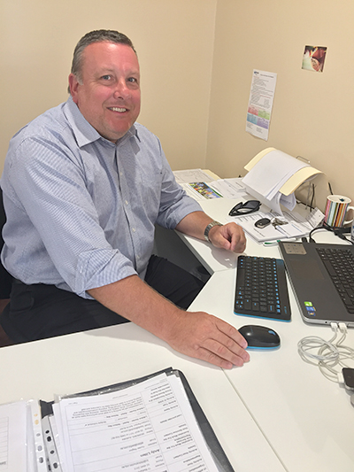 Andy Litten at his Nelson Bay Workskil desk. Photo by Jewell Drury