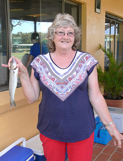 Marion Smith proudly displays the whiting she successfully angled.