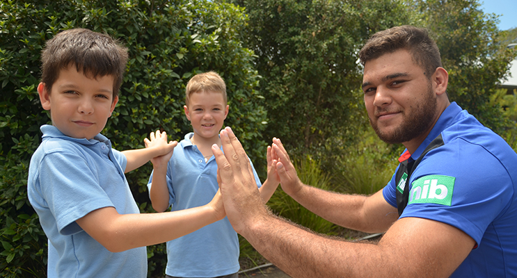 HIGH FIVE: Knights Keanu Dawson with Jack Browne and Korban Patteson.