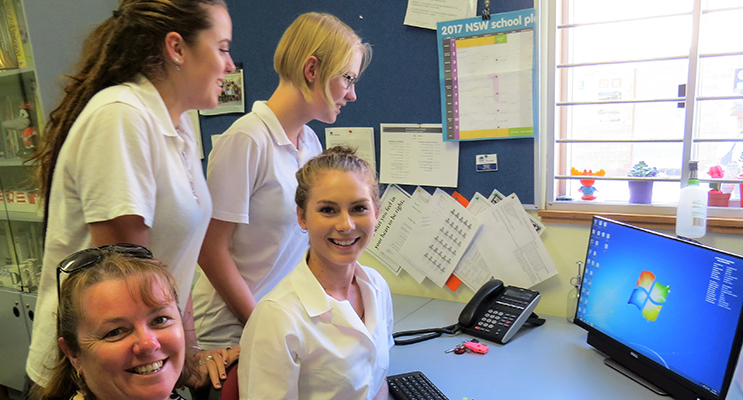 HSC support: BCS Deputy Principal Mrs Deb Gilbert mentors current Year 12 students Bonnie Hay, Bianca Mason and Kaitlyn Gregory.