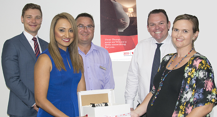 Back: Daniel Mueller, Product Manager, Jason Russell, Nelson Bay Bank Manager, James Cudmore, State Manager, Front: Safia Deen, North Coast Regional General Manager and Rebecca Nulty receiving a gift pack for her baby to be. Photo by Square Shoe Photography