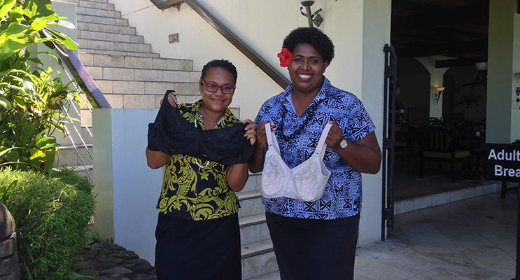 Staff of a hotel in Fiji receiving bras for women in their local area. Photo supplied by Donna Campton