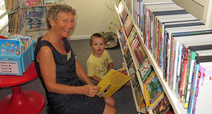 Volunteer librarian Beatrice Weeks with young reader Jack Dexter.