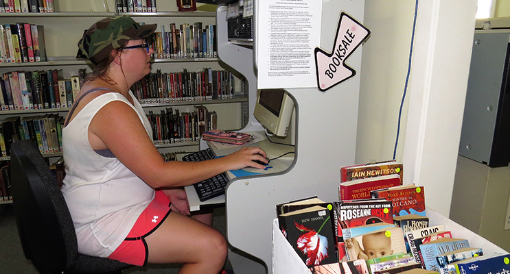 Ashley Dexter uses the computer at Bulahdelah Library.