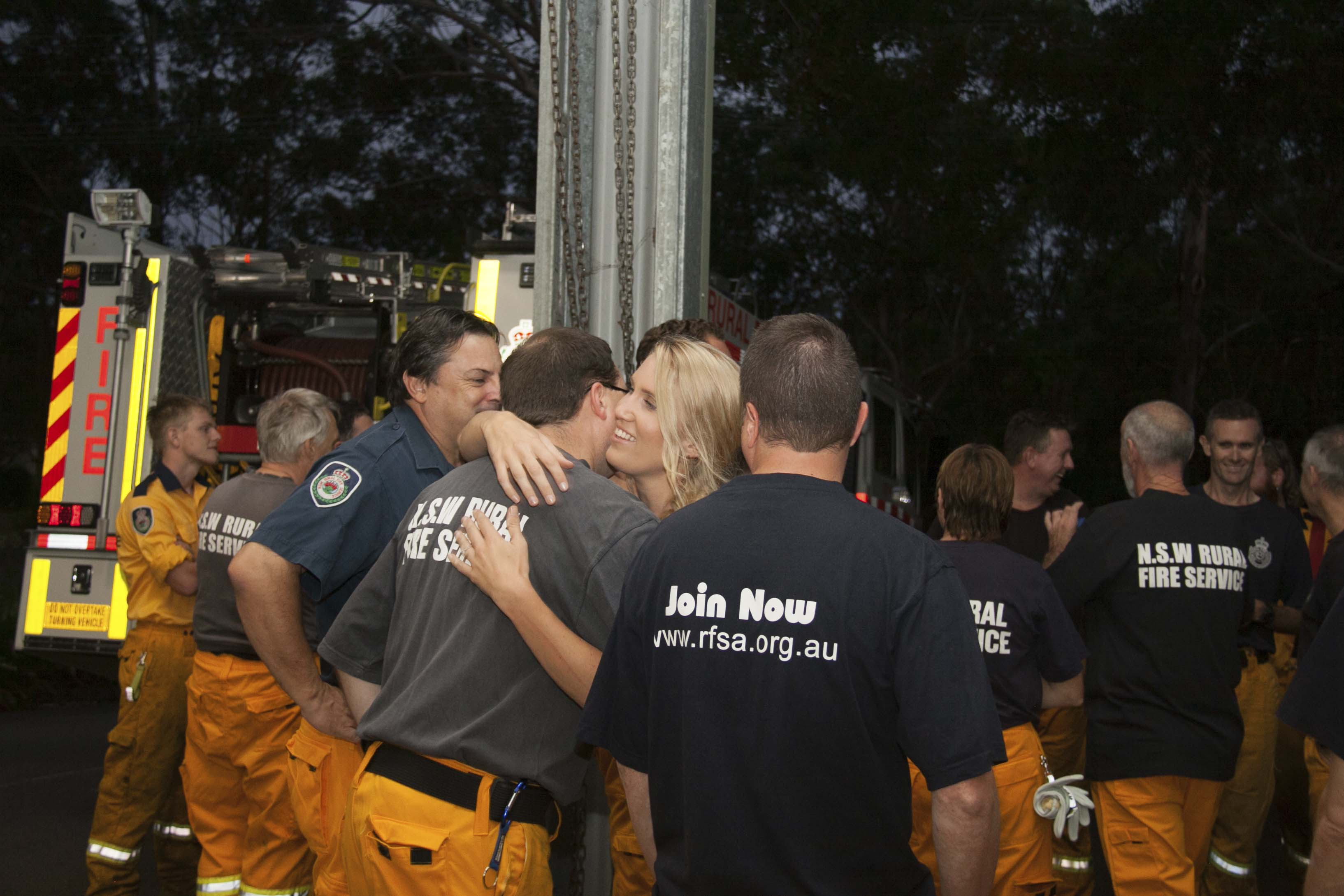 Congratulations hugs being given out by Medowie RFB members.