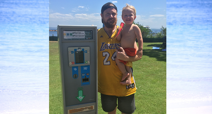Trent Kemp pictured with son Kobe has had enough of  locals having to pay for parking. Photo by Jewell Drury