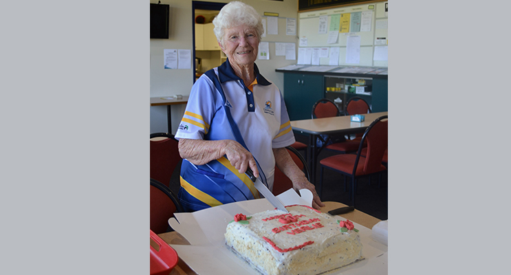Verlie Gray cutting her birthday cake.