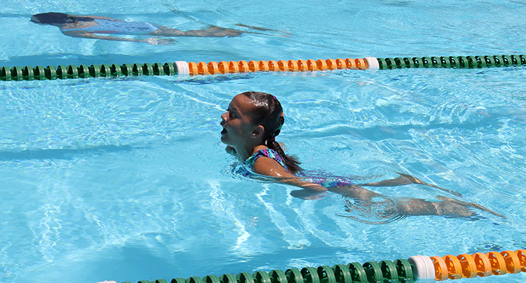 Swimming Carnival: KPS student Lexi puts in a huge effort in the breaststroke event.