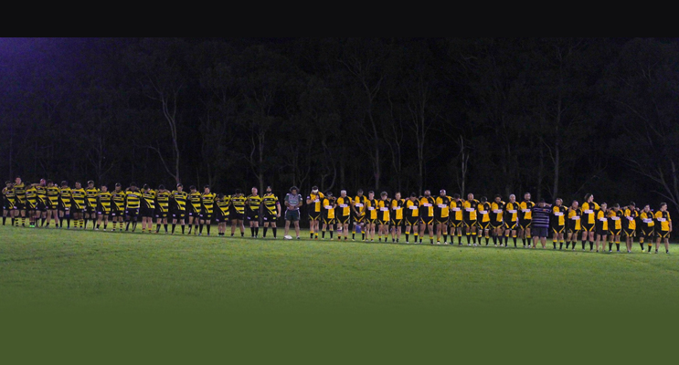 Cessnock and Medowie paying their respects to fallen club member with a minute's silence.
