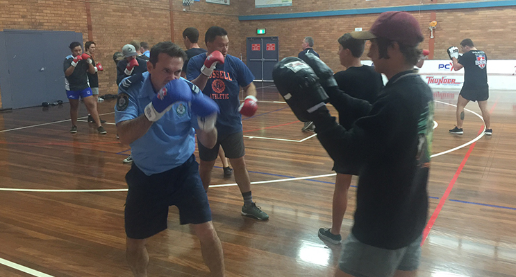 Youth and Police get into boxing training and strengthen their relationship in the community.