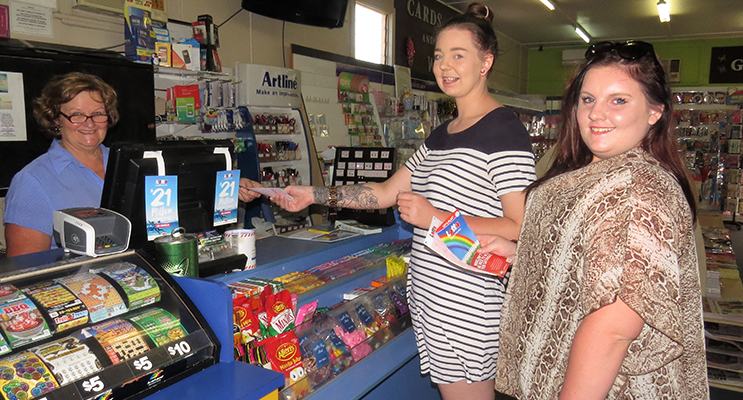Bulahdelah Newsagent Sue Chick with customers Tiffany Wood and Maddie Harvey, hoping the local luck continues.