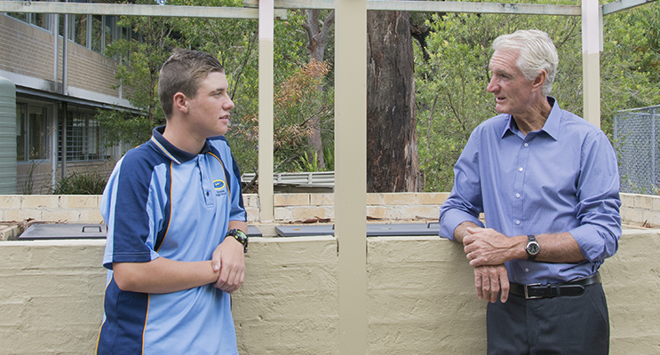 Cody Pool with Stephen Jennings having a yarn about the barbecue Cody helped build. Photo by Square Shoe Photography