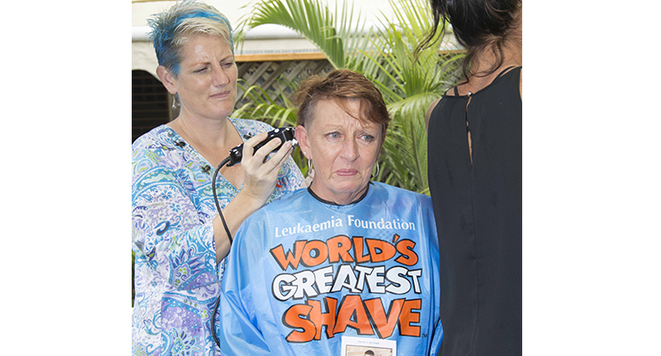 : Cheryl Rees with Shalee Morley (shaving), in respect of her 25-year-old nephew taken too soon and for the survivors who BEAT cancer.     Photo by: Square Shoe Photography