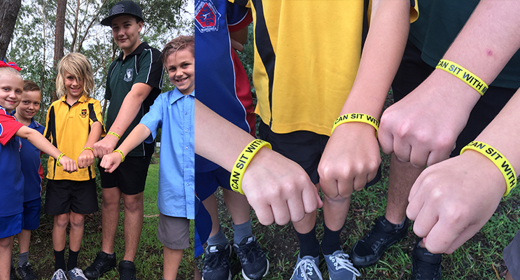Medowie Schools standing together against bullying - Adryane and William Montgomery from Wirreanda PS, Oscar Smith from Medowie PS, Attila Worley-McGrath from Irrawang HS and Alexander Moore from Medowie Christian School.(left) Hands in, making a stand against bullying. (right)