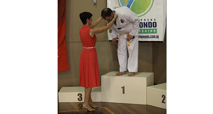 Kate Washington presenting a medal at Port Stephens Taekwondo Championships.