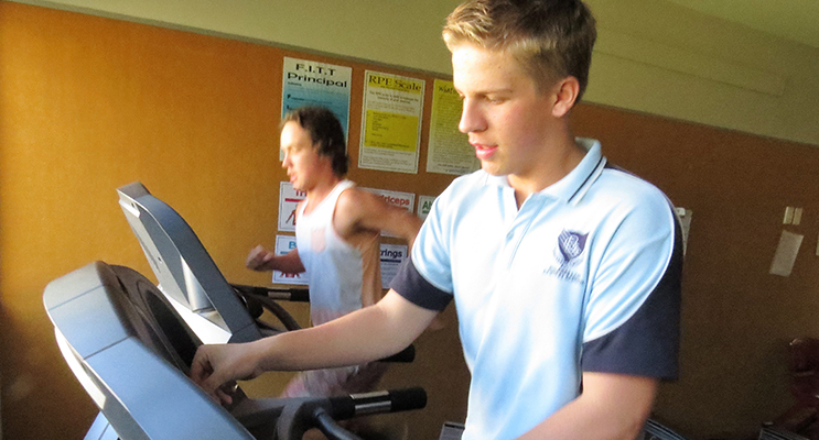 Lachlan Blows and Matthew Selby pound the treadmills.