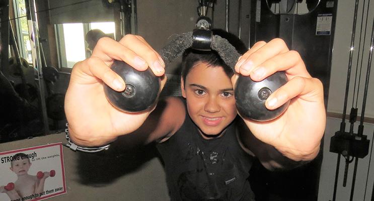 : Year 8 student Jett Krohn from Tea Gardens burns his energy off in the school's fitness centre.