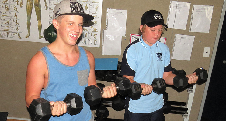 Teamwork: Lachlan Blows with Angus Devon in the school's fitness centre.