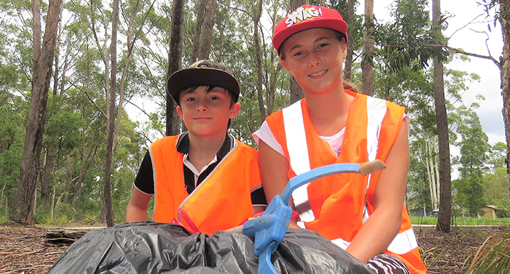 Clean Up Australia: Corey and Amber Cunningham clear rubbish to keep the area tidy.
