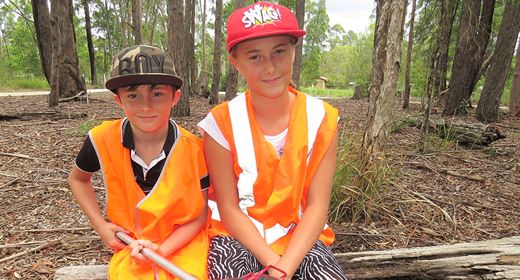Clean Up Australia: Corey and Amber Cunningham clear rubbish to help keep the area tidy.
