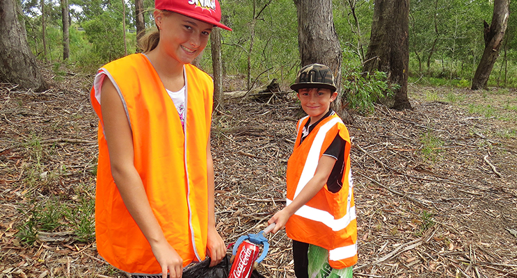 : Clean Up: Amber Cunningham and her brother Corey pick up rubbish left in the Mountain Park at Bulahdelah