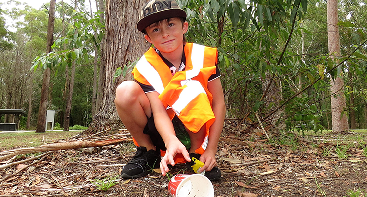 Clean Up: Nine-year-old Corey Cunningham picks up rubbish left by others.