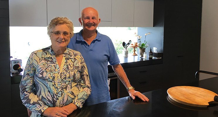 The home's owners, Diana and Geoffrey Hamilton, in front of the Ned Kelly-style kitchen windows.