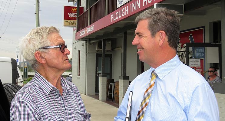 Federal Member for Lyne Dr David Gillespie talks with resident John Pringle at the Listening Post session in Bulahdelah.